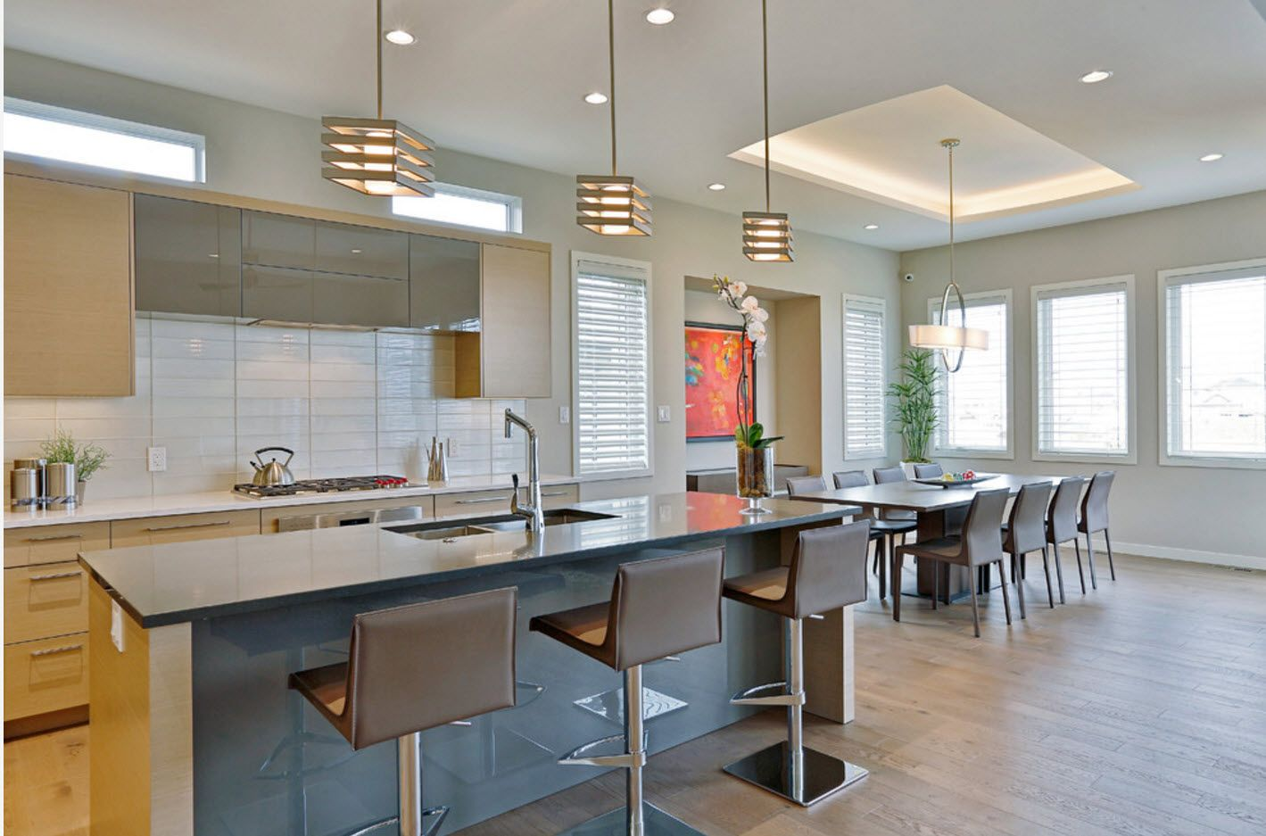 Strict lines of the modern hi-tech kitchen interior in tender pastel colors