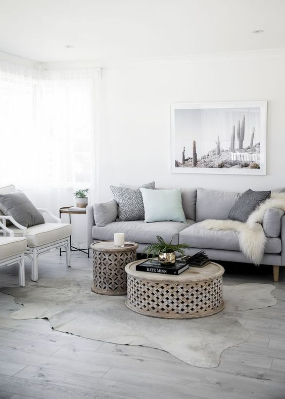 White and gray design fo the modern living room with couple of coffe tables