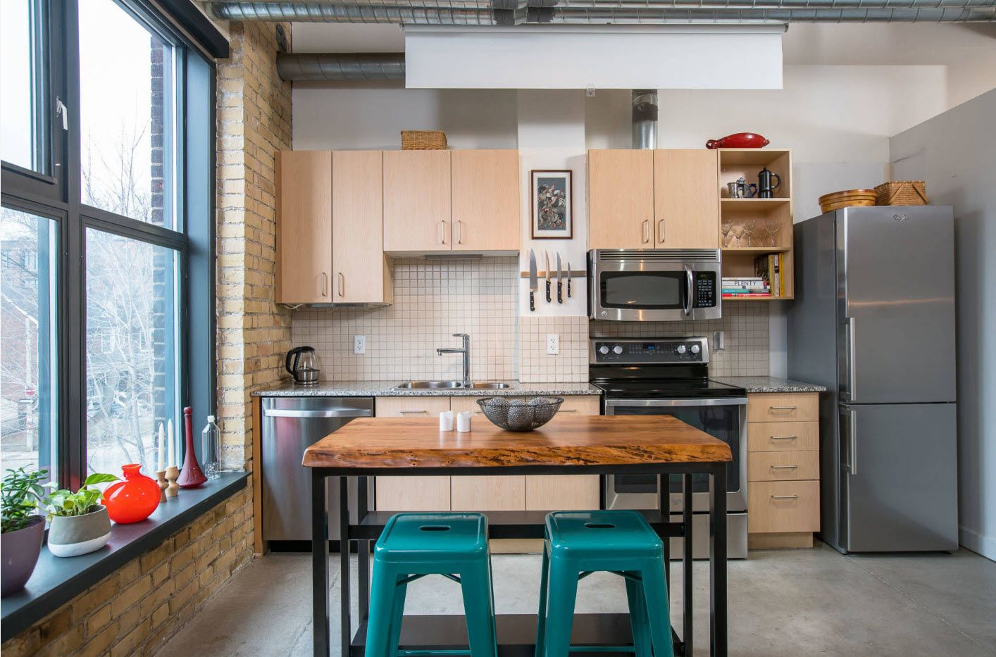 Wooden notes in the kitchen with brickwork and green plastic chairs