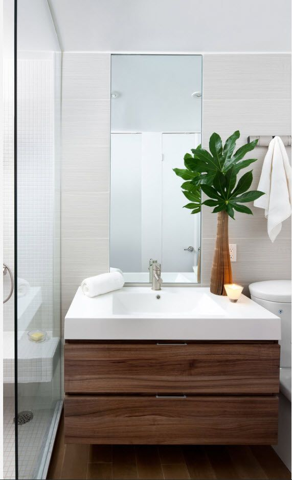 White sink and brown wooden hovering vanity