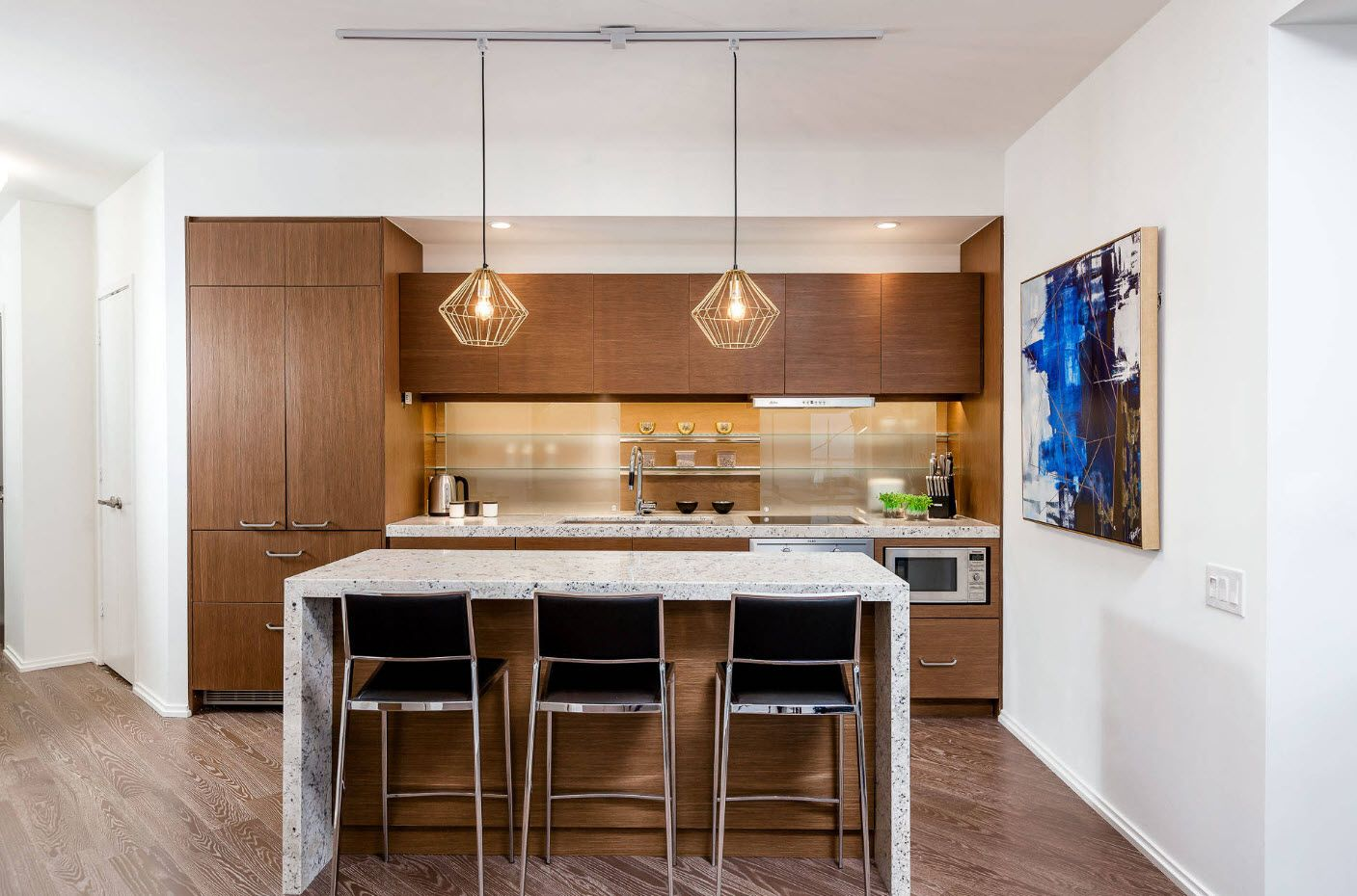 Neat wooden facades of the modern spacious kitchen with black chairs