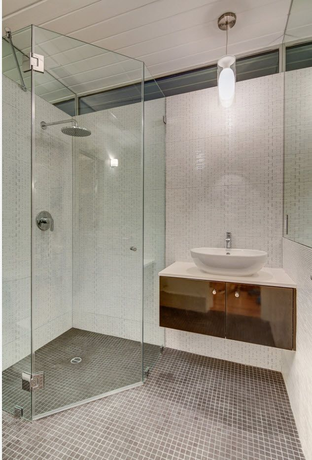 Bathroom full of glass and gray surfaces