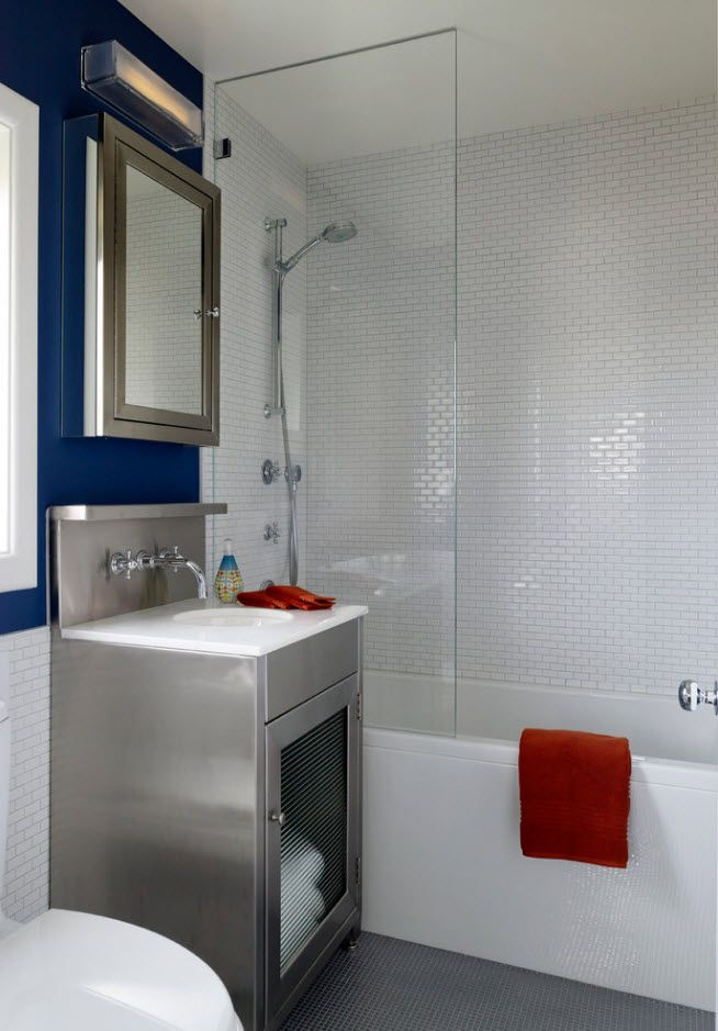 100 Small Bathroom Decoration Modern Design Ideas. Glossy interior of the modern bathroom with blue accent at the mirror