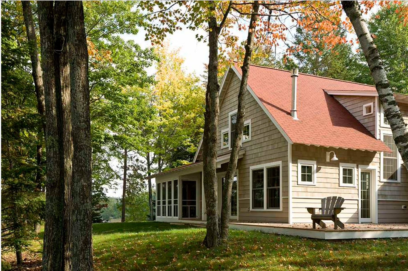 Gorgeous planked suburban house with red shingled roof