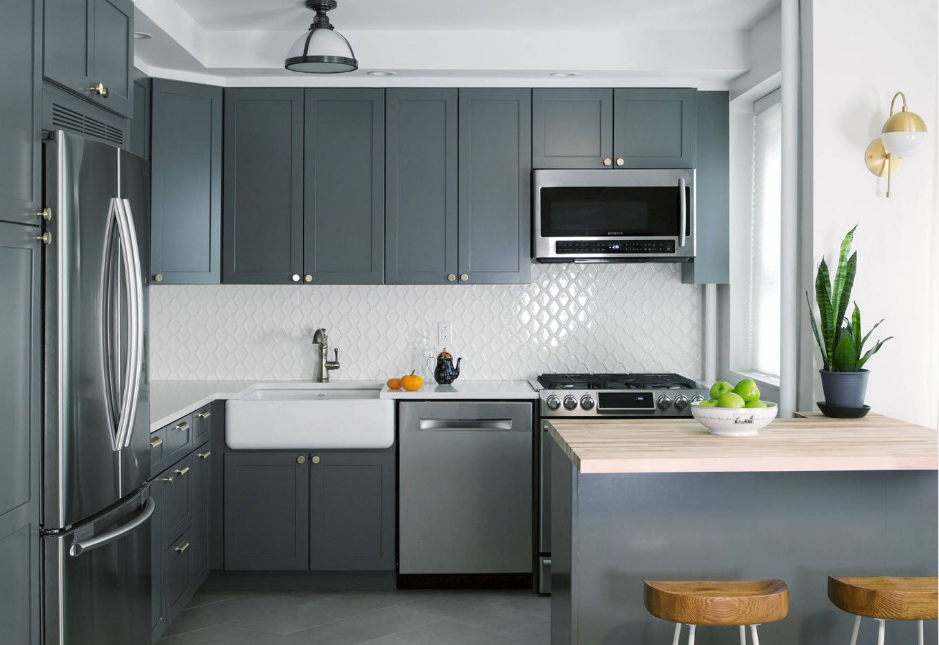 Conventional design theme for dark matted surfaces and mosaic white splashback