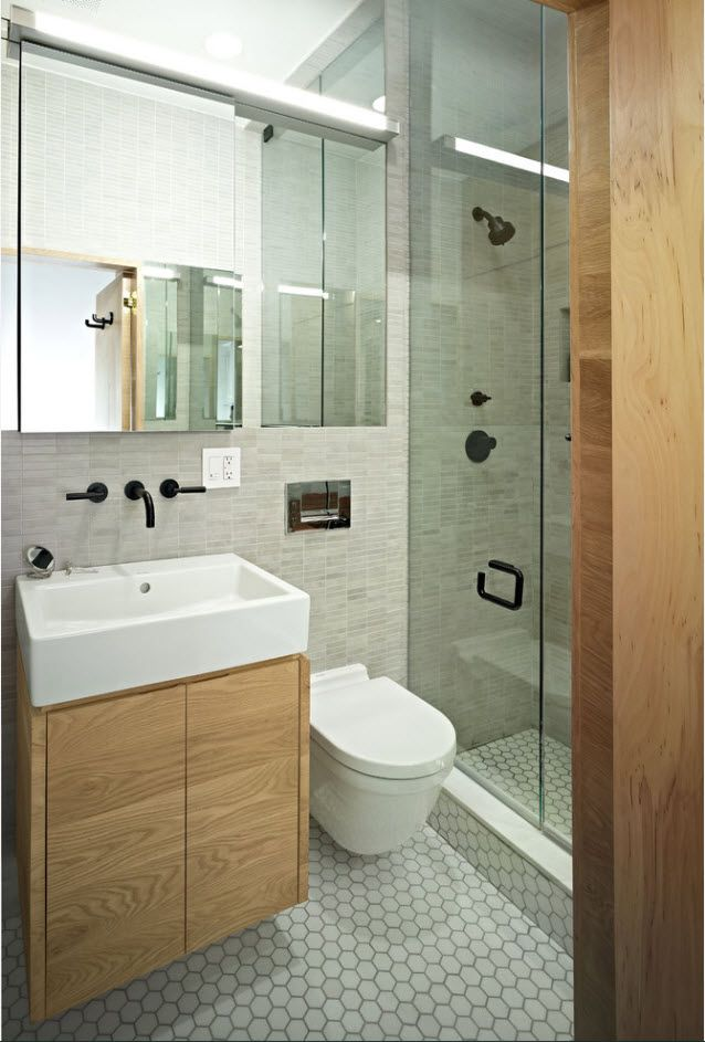 Modern bathroom design with built-in black tap and valves