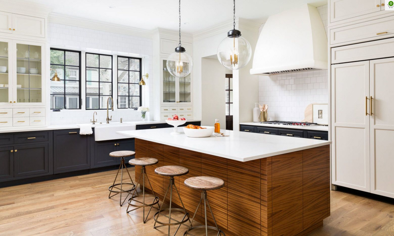 Wooden sides of the kitchen island and round bar stools