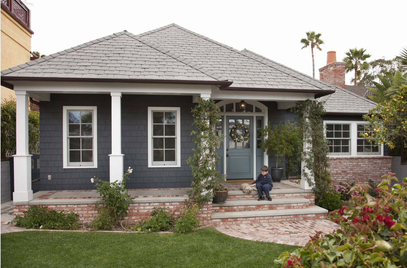 Modern American rustical style with gray walls and complex gabled roof