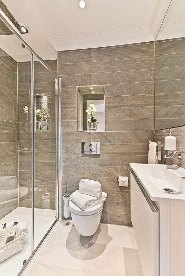 Gray bathroom with marble imitating tiled accent wall