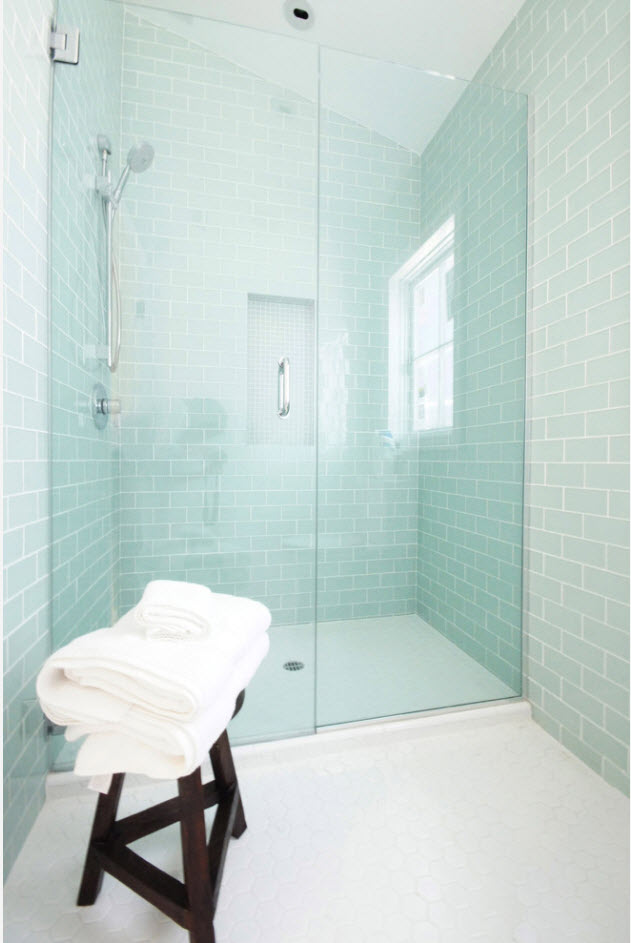 Light blue PVC glass filter on the shower partition adds cool tint to the overall atmosphere of the bathroom