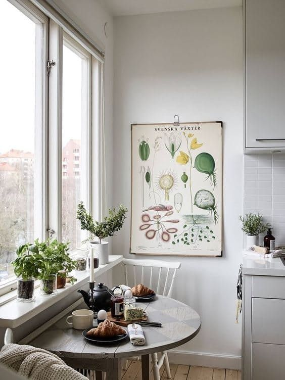 Modern urban kitchen with semicircular table at the large window