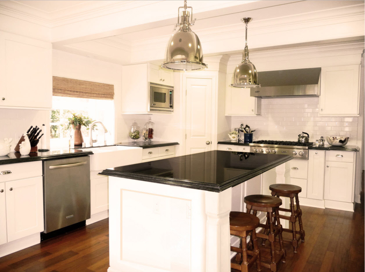 Black spectacular glossy countertop of the angular designed kitchen in classic style
