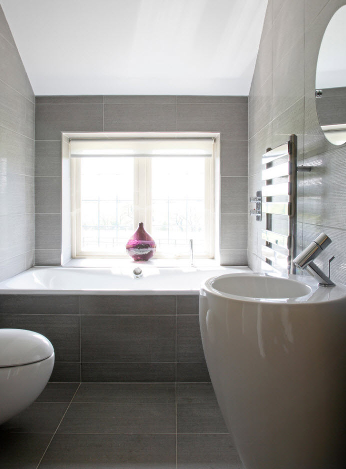 Oval theme in the bathroom: every detail and functional element has oval and round forms