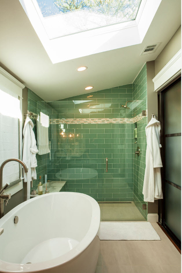 Slanted ceiling bathroom with green accent wall at the shower zone
