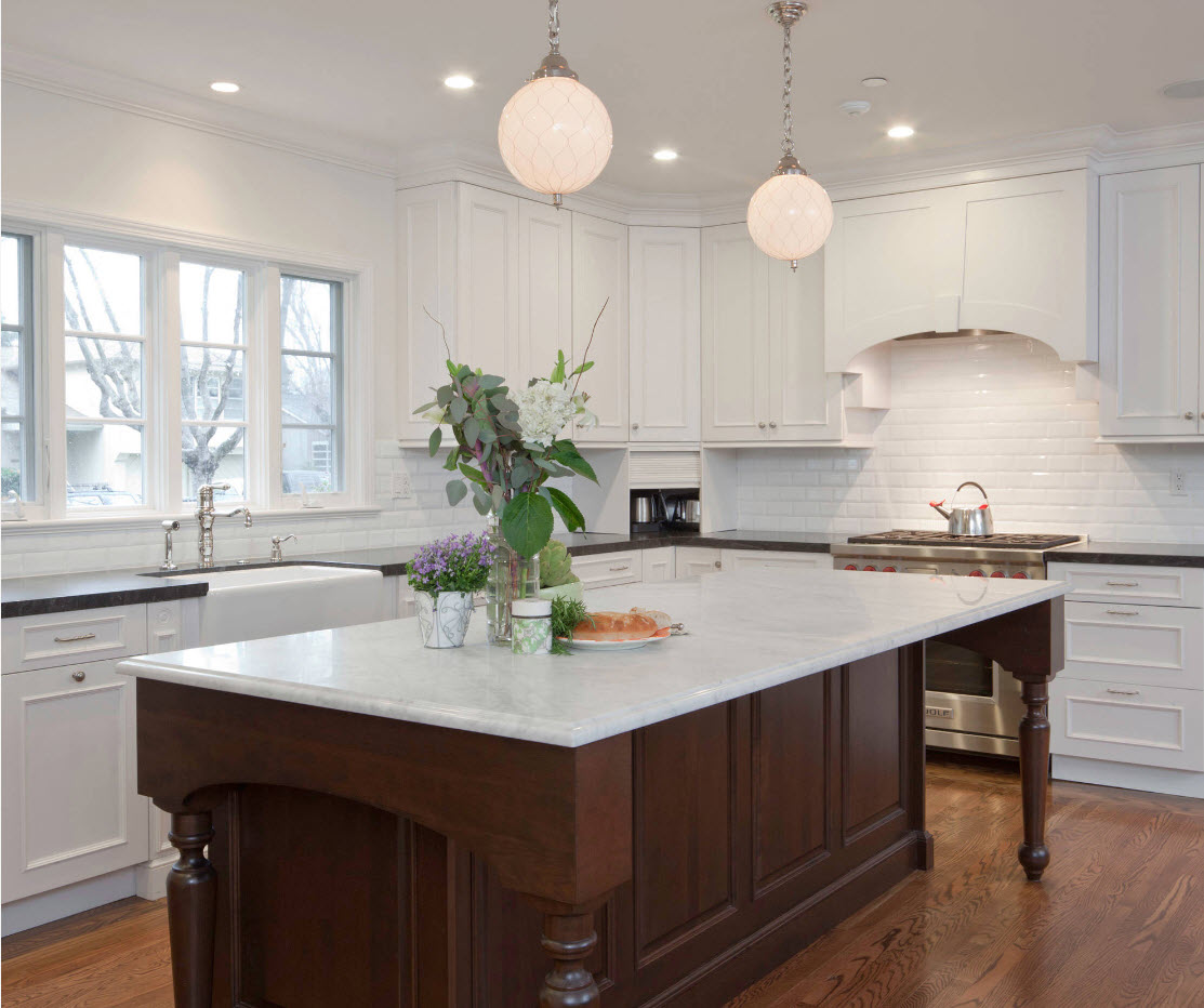 White interior of the kitchen with dark wooden island