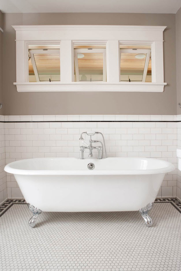 Classic separate standing bathtub and metro tile at the wall