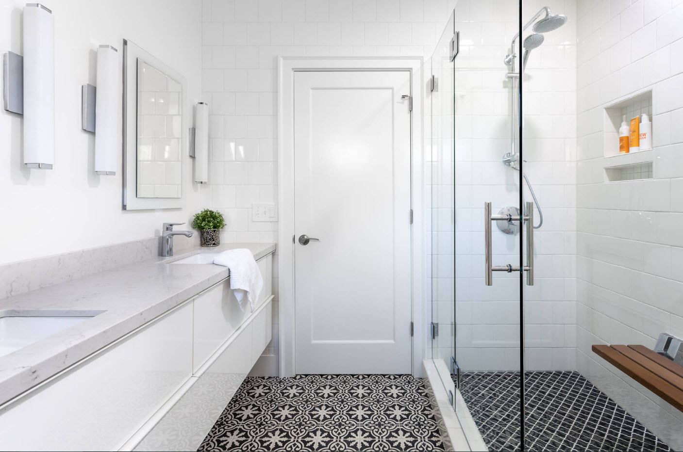 Contrasting dark tiled floor and contemporary styled bathroom