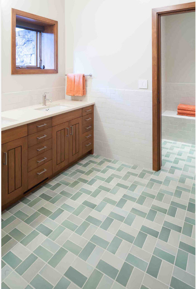 Herringbone tiled floor with white and green pieces