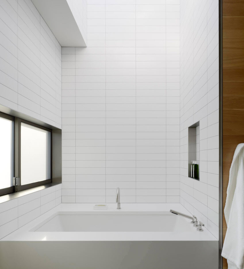 Minimalistic white atmosphere of the bathroom with small window