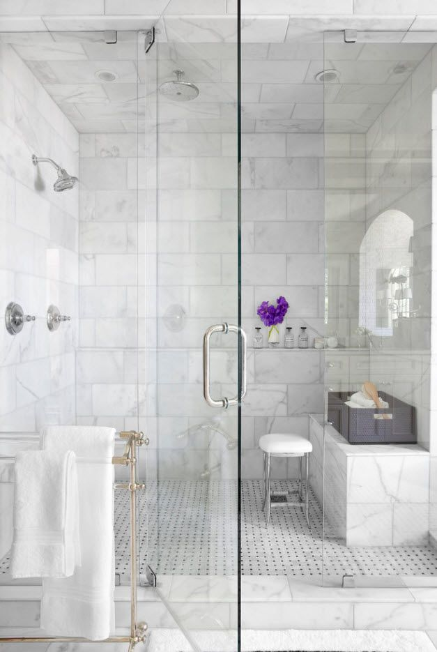 light gray marble imitating tile with streaks in the glass zoned shower space