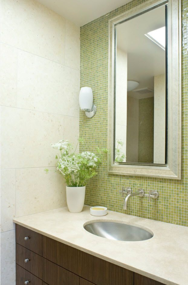 Small bathroom with neat sink and splashback of green mosaic tile