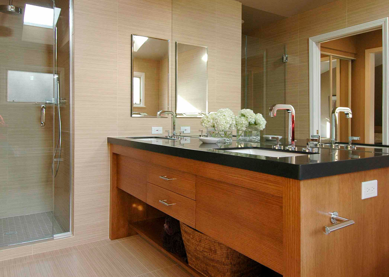 Wooden big vanity in the large private house's bathroom