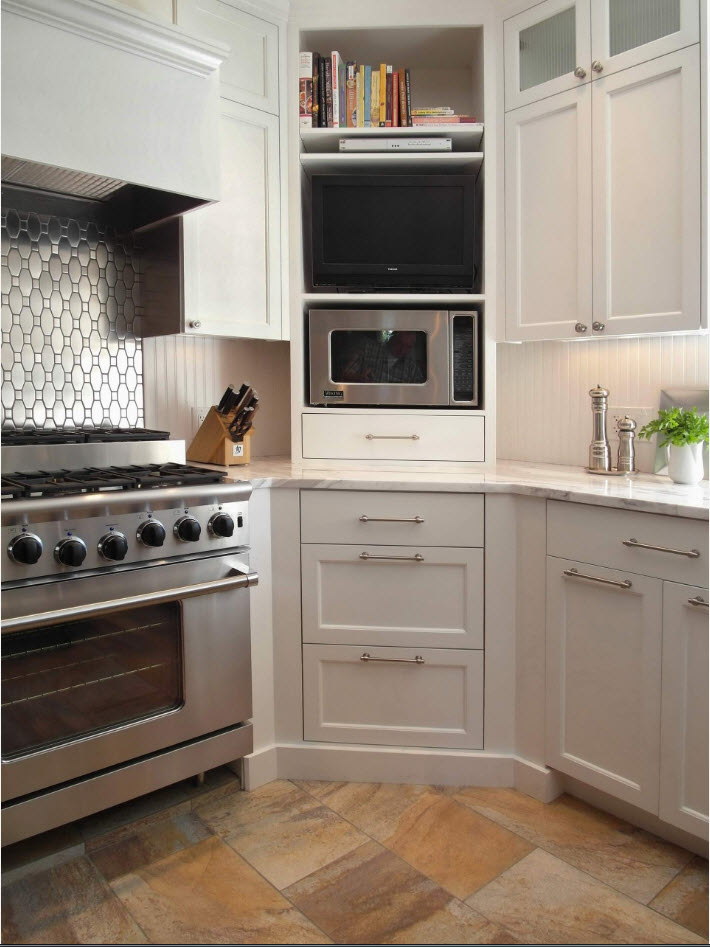 All necessary appliances at the geometrically complex kitchen