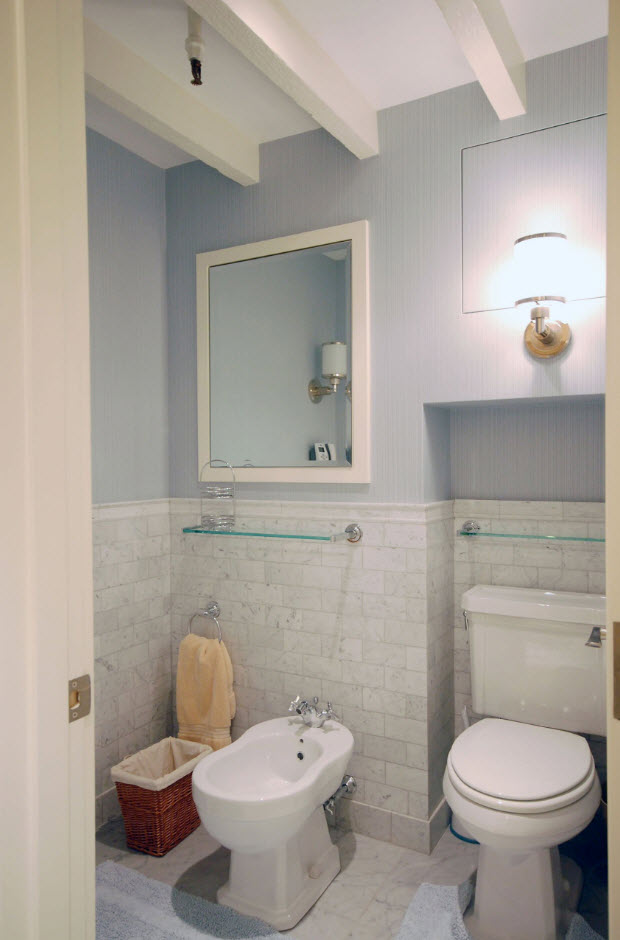 Neat classic bathroom space with pale blue painted wall tops