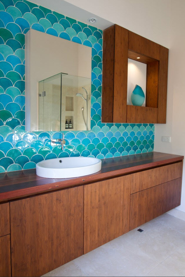 Light blue glossy tile for the wall decoration and wooden furniture pieces