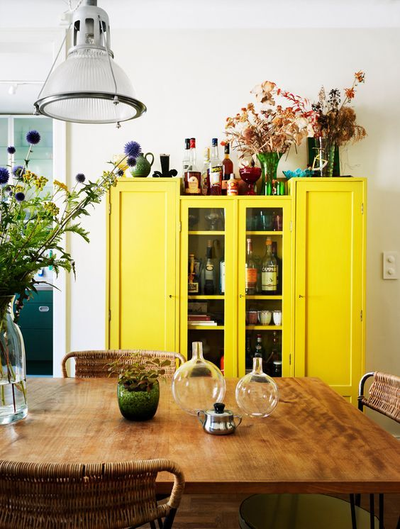 Rustic style in the kitchen with garish retro yellow cupboard