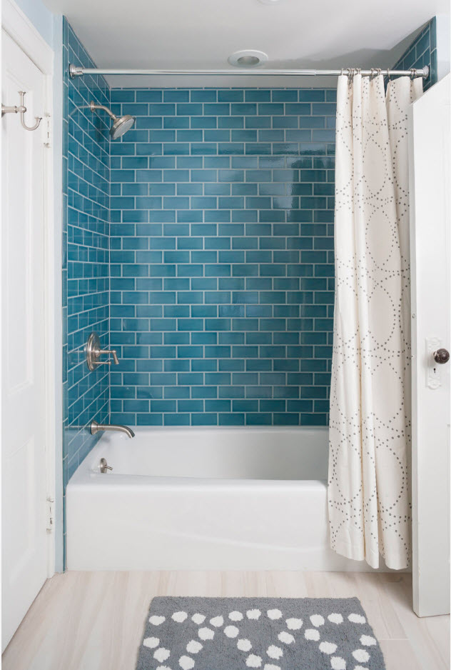 Gorgeous looking blue surfaces of the tiled bathroom walls