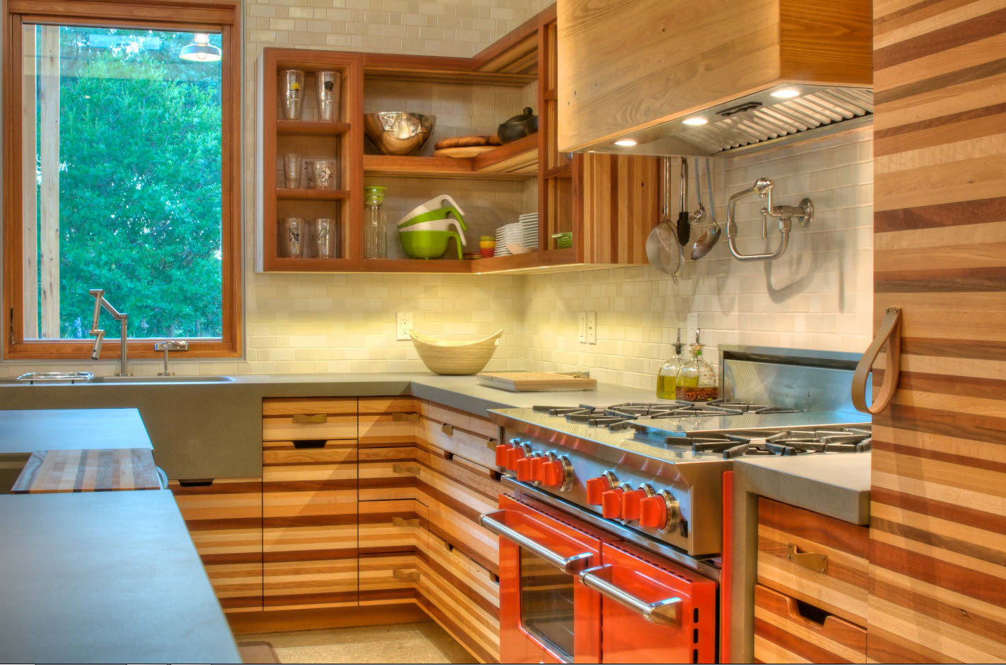 Unusually laminated kitchen furniture set with modern red hob facades