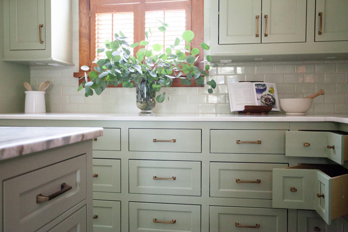 Angular Kitchen Layout Design Ideas 2017. Uniform pale green storage system in classic style
