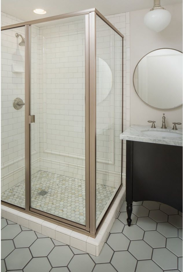 Classic bathroom interior with separated shower zone and black vanity with aluminum bent tap