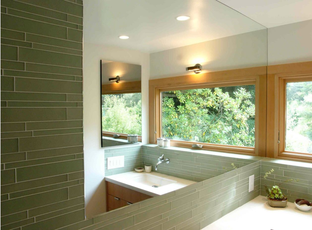 Private house bathroom with open layout and large panoramic mirror