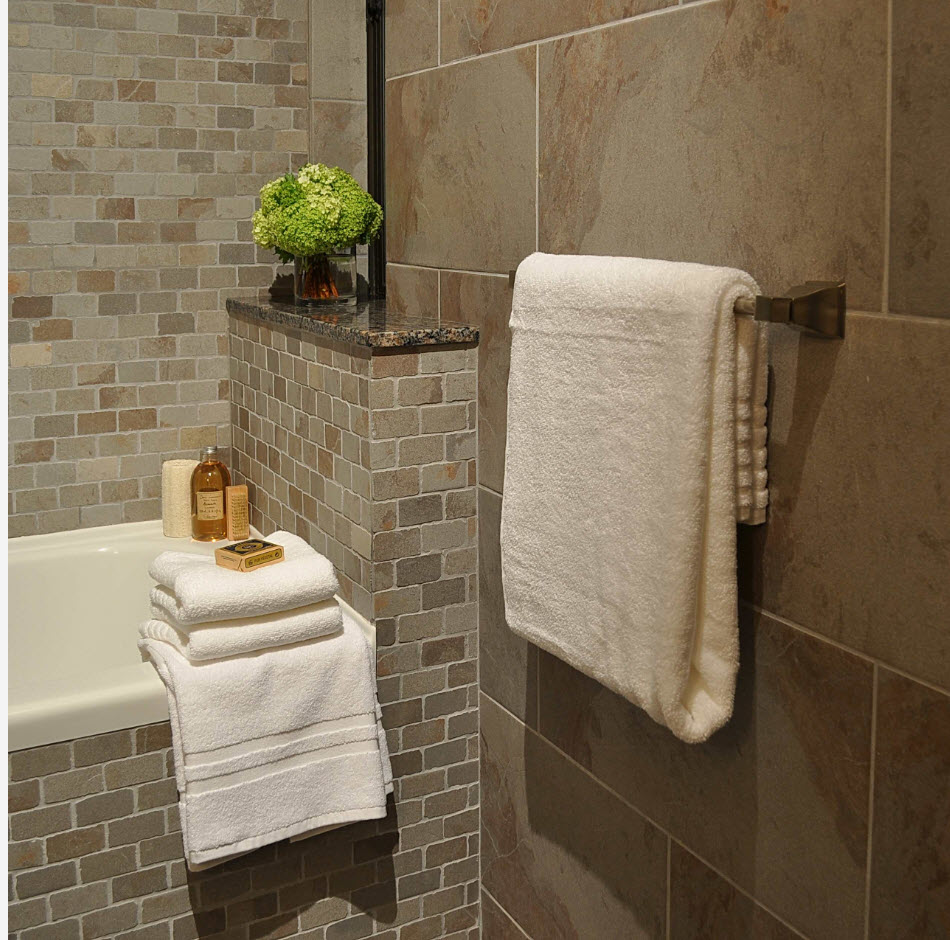 Gray and beige colors of the tile in the modern bathroom