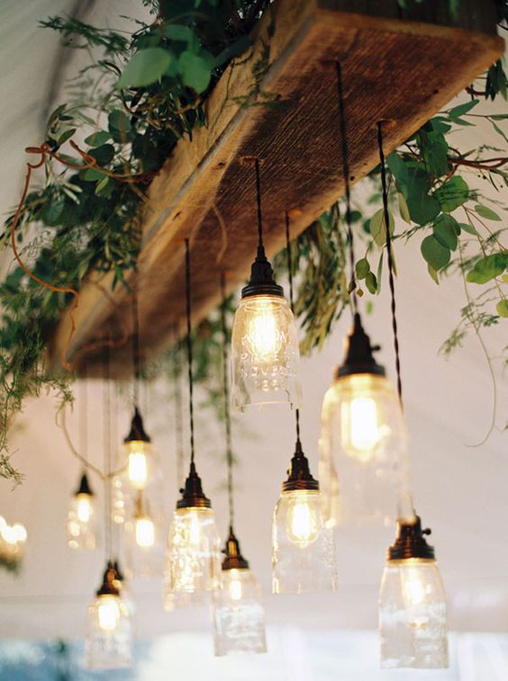 Garland of mere bulbs at the wooden suspended basis at the kitchen