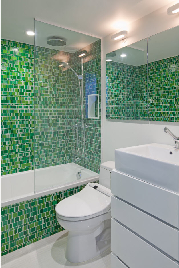 Totally decorated with small green palete mosaic tile bathroom in modern style