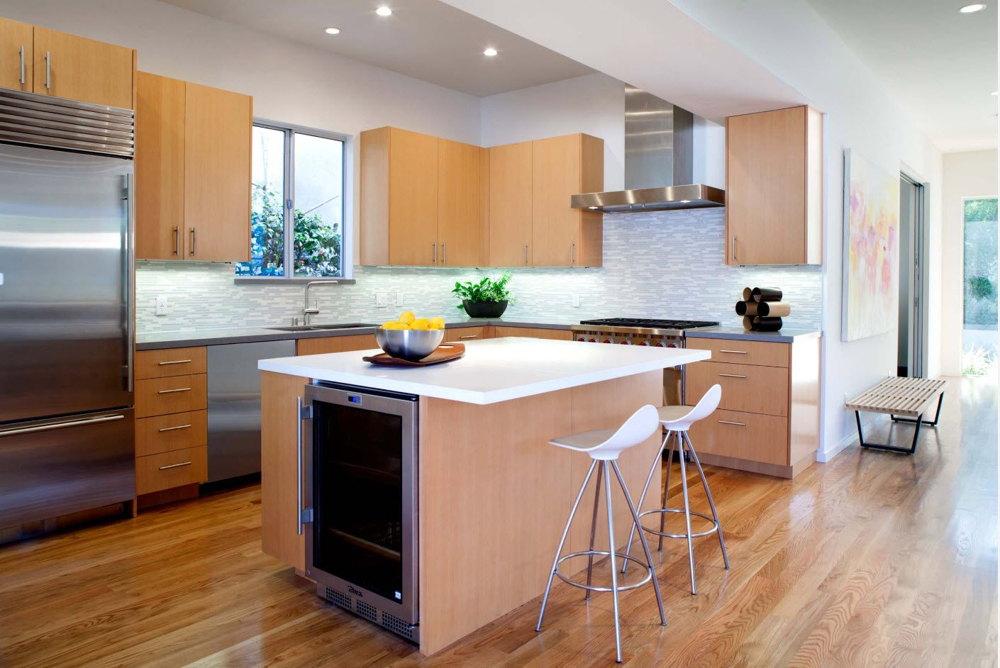 Wooden materials all over the hi-tech styled kitchen