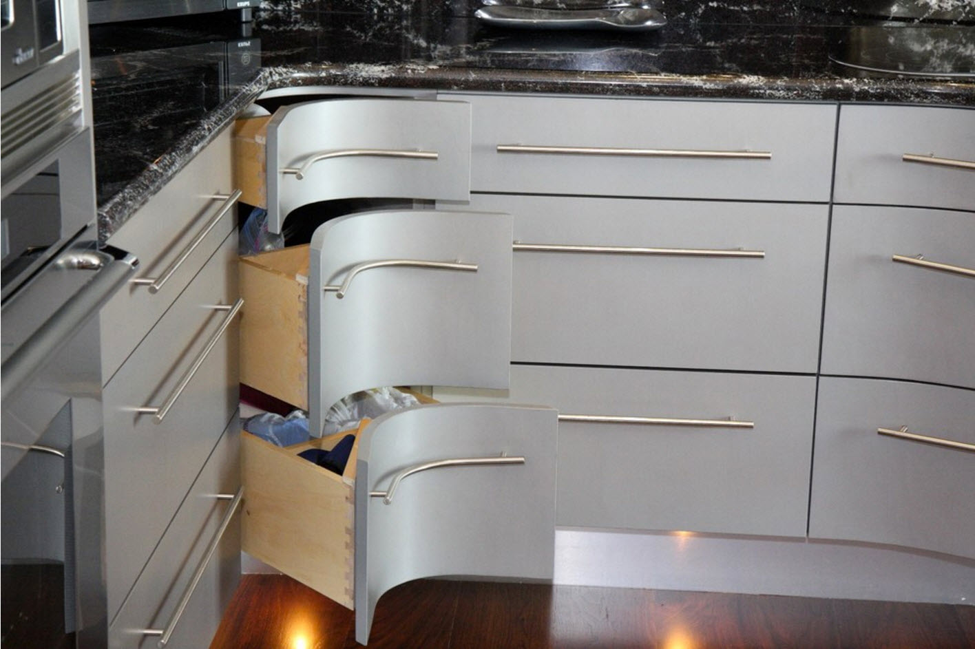 Oval shape top surfaces of the pullout kitchen drawers