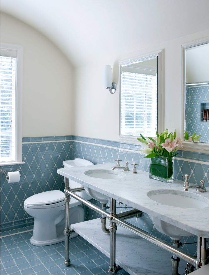 Marine style in the bathroom is achieved by bottom tier rhomb ceramic tile
