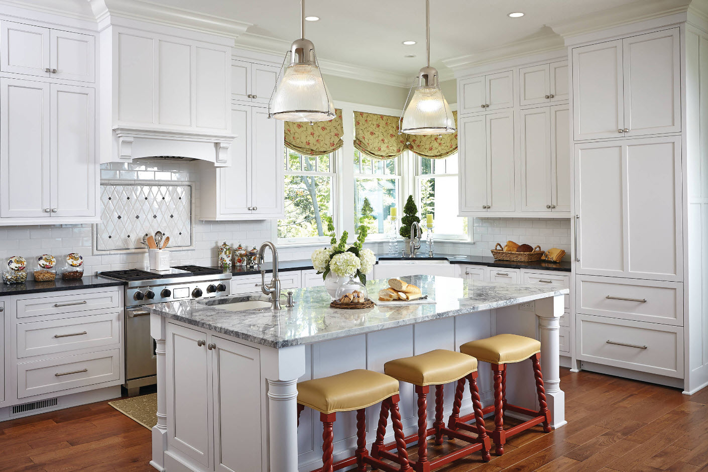 Classic funrished kitchen with glass lamps and figure carving of the furniture