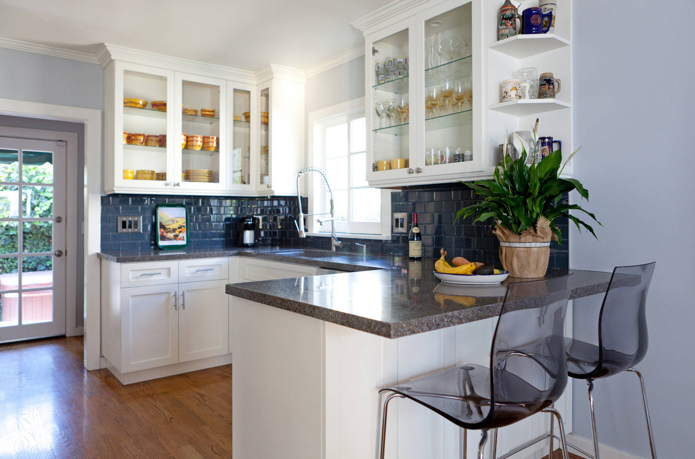Glass top tier cupboards and glossy modular countertop