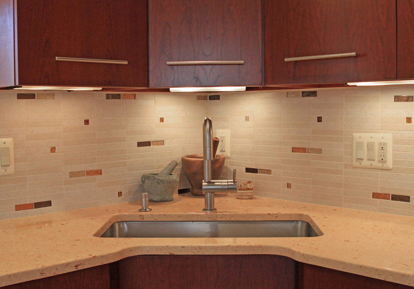 Modern style with dark wooden surfaces and large stainless steel sink