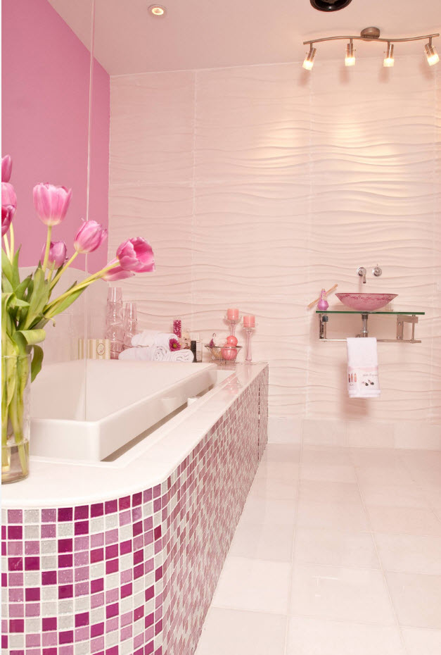 Pink theme in the modern bathroom with pebbled bathtгb side