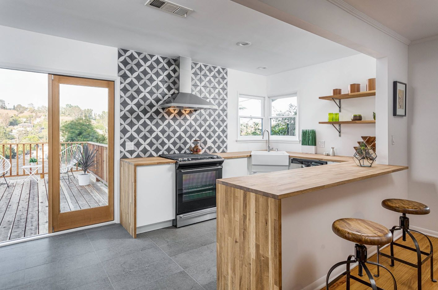 Extractor hood at the background of contrasting wall pattern