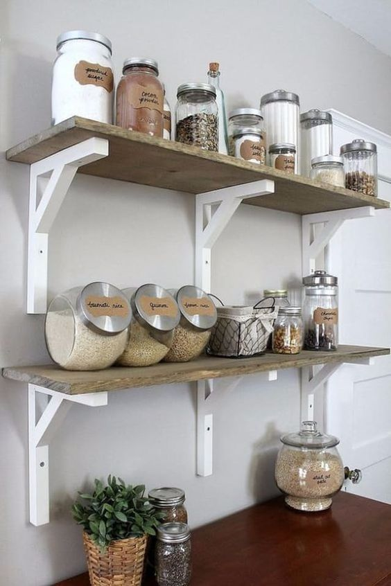 Nice side-headed glass bottles for cereals in one common style looks spectacular in rustical kitchen