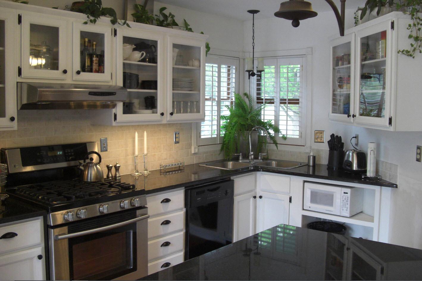 Angular Kitchen Layout Design Ideas 2017. White neat white furniture facades among the dark spots of appliances