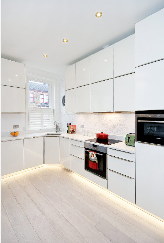 Iseally white kitchen interior with bottom LED lighting
