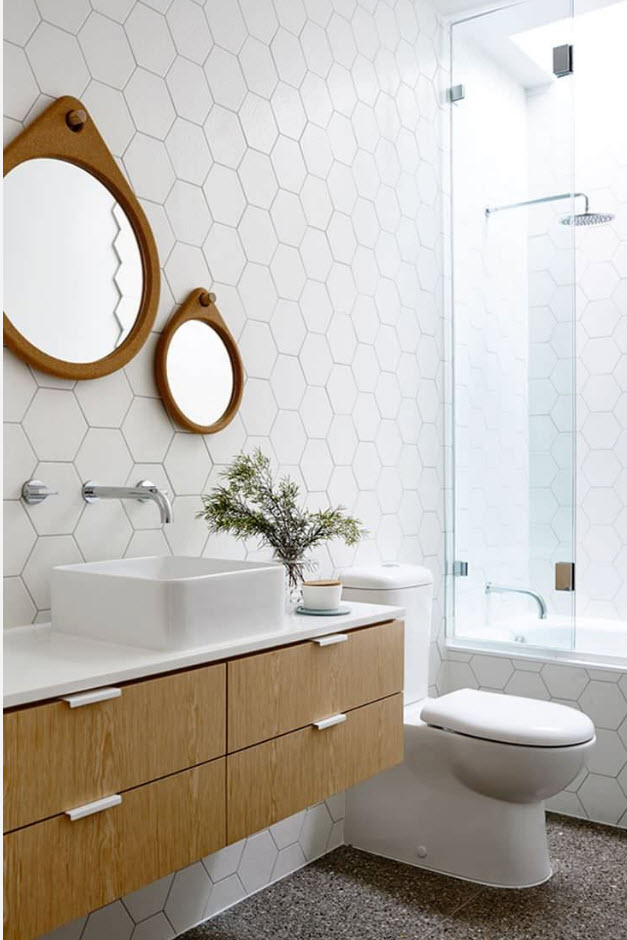 Classic atmosphere of the bathroom with round mirrors and modular vanity